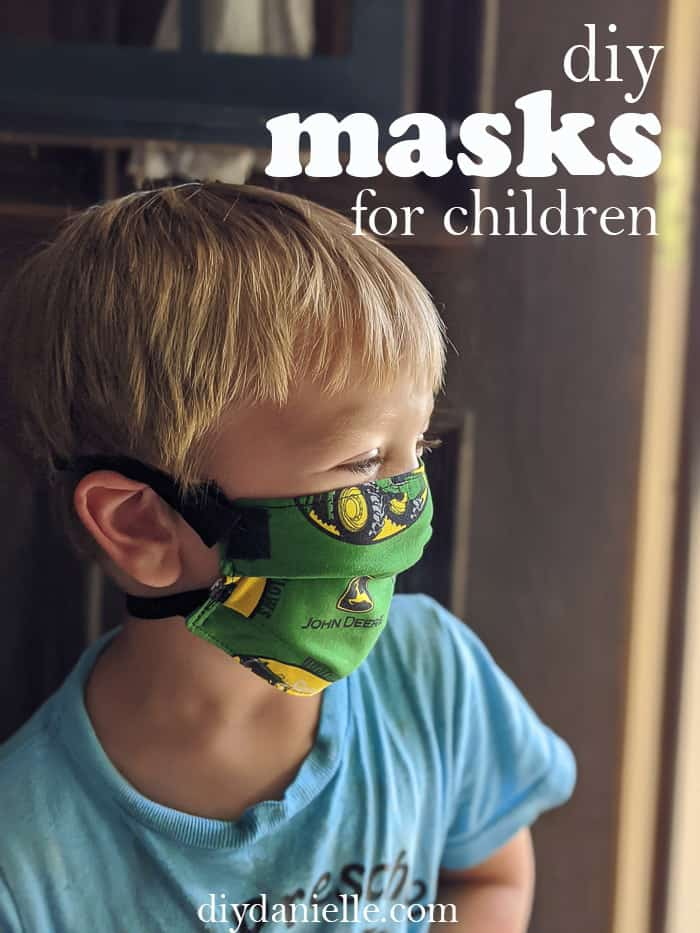 DIY Masks for Children: 3 year old boy with blond hair wearing a John Deere mask with breakaway straps.
