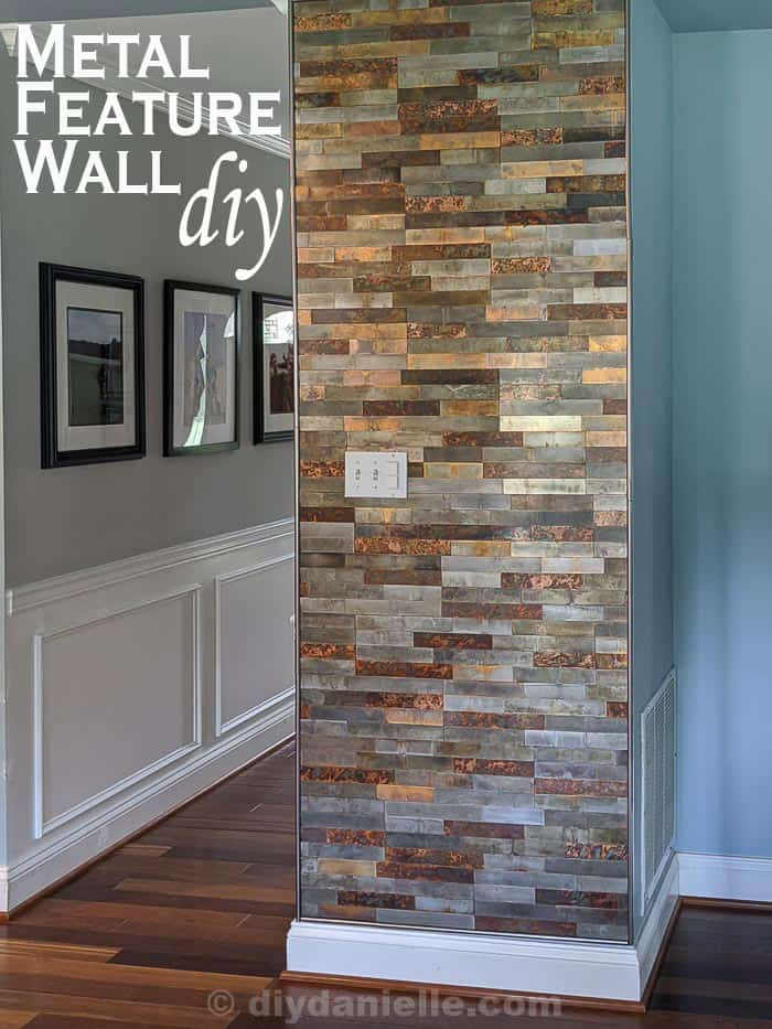 Metal Feature Wall DIY. Light blue kitchen walls next to a feature wall made with distressed metal stick on tiles.