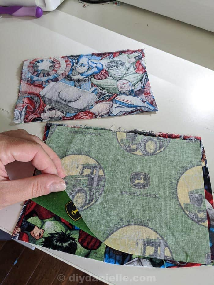 Two pieces of woven cotton fabric placed right sides together.