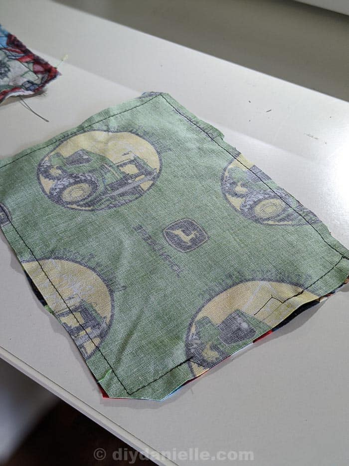 Fabric sewn right sides together with a gap left on the right side. Corners clipped at a diagonal without clipping the stitching.