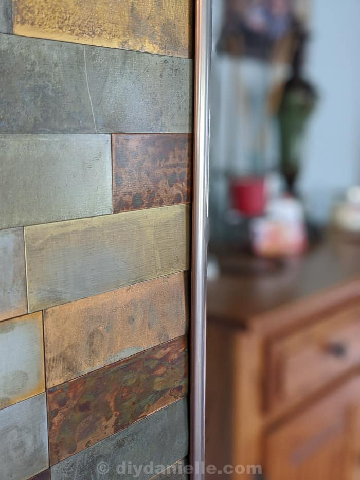 Trim for our metal feature wall. Closeup shot of the slight gap between the top of the tiles and the trim.