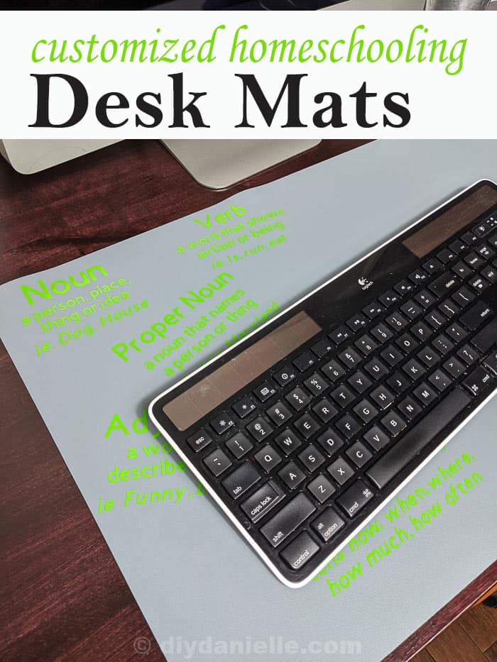 Customized homeschool desk mat that is under a keyboard. The 3rd grader's mat shows parts of speech and their definitions.