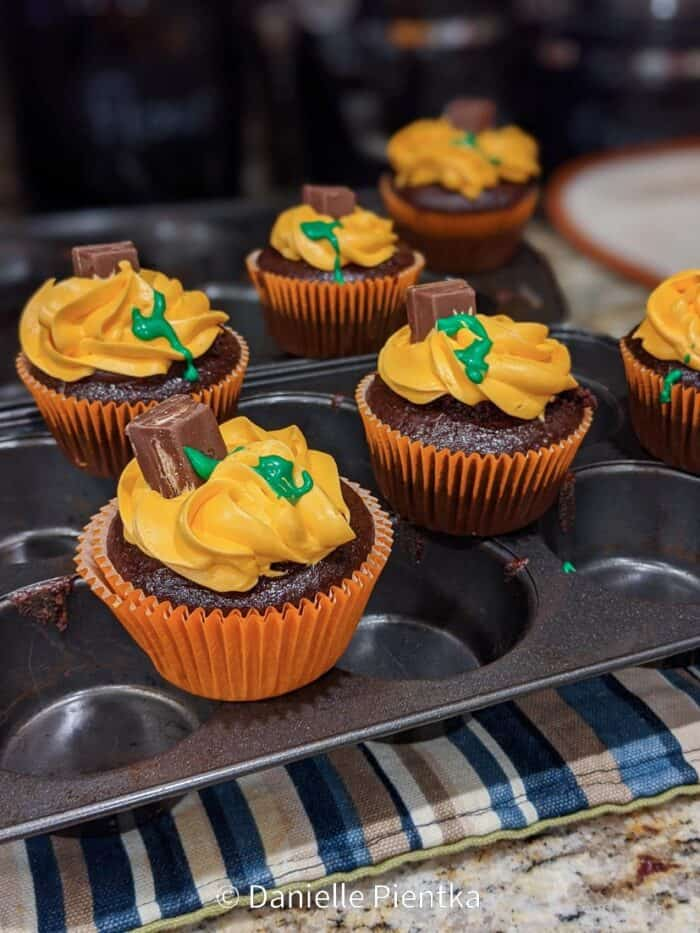Pumpkin themed pumpkins for my son's birthday. These are chocolate cupcakes without egg because I'm allergic to eggs.