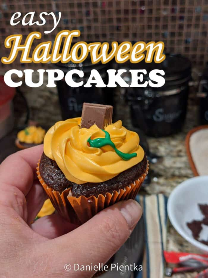 Easy Halloween cupcakes: Chocolate eggless cupcakes with orange frosting and a candy stem.