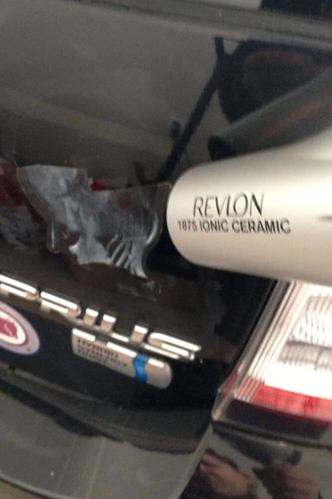 Using a hair dryer to remove the decal.