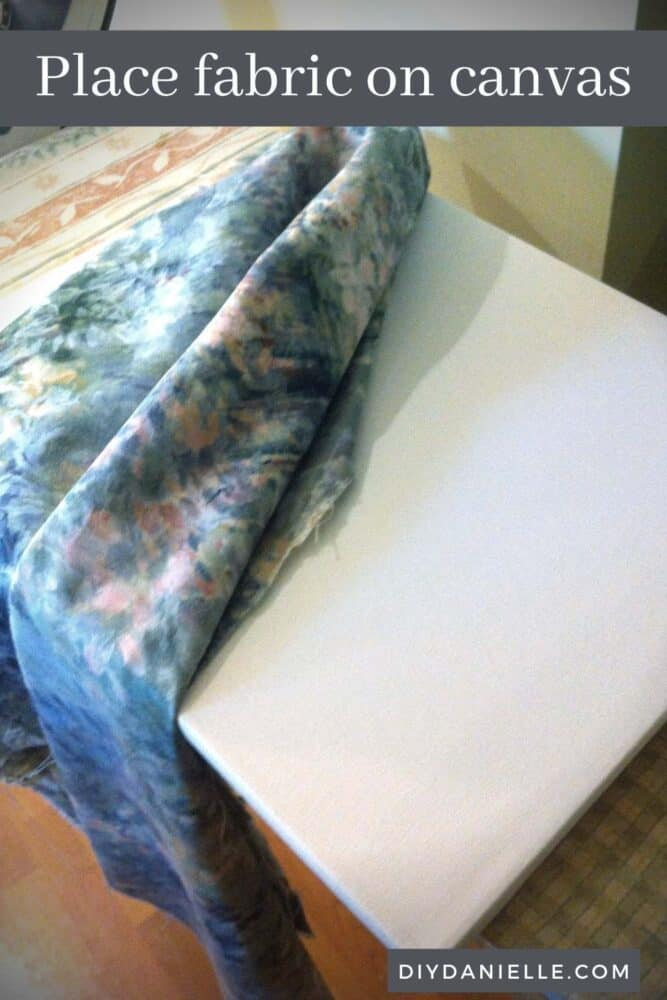Placing the fabric on the canvas.