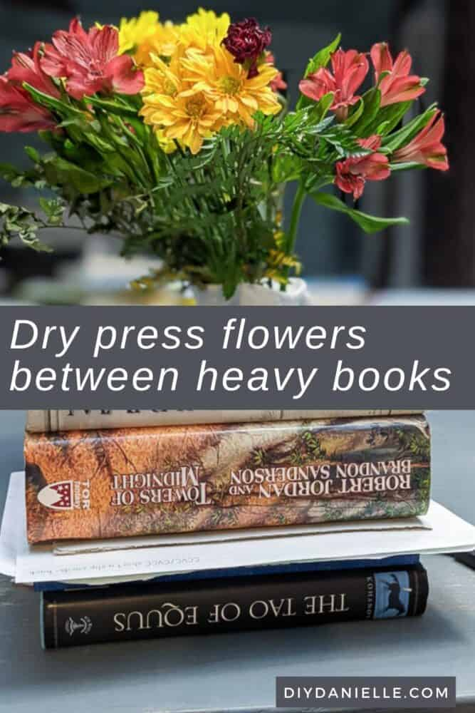 Using heavy books to press the flowers. I'll leave these for a few weeks.