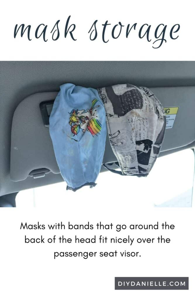 Masks with elastics that go around the back of the head can be put around the car's passenger side visor.