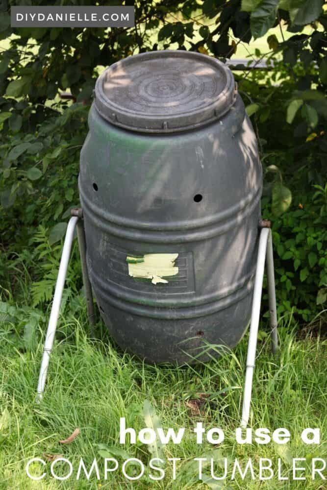 This large compost tumbler can be turned manually. It is black to attract heat, and has holes for drainage and water to moisture the compost inside.