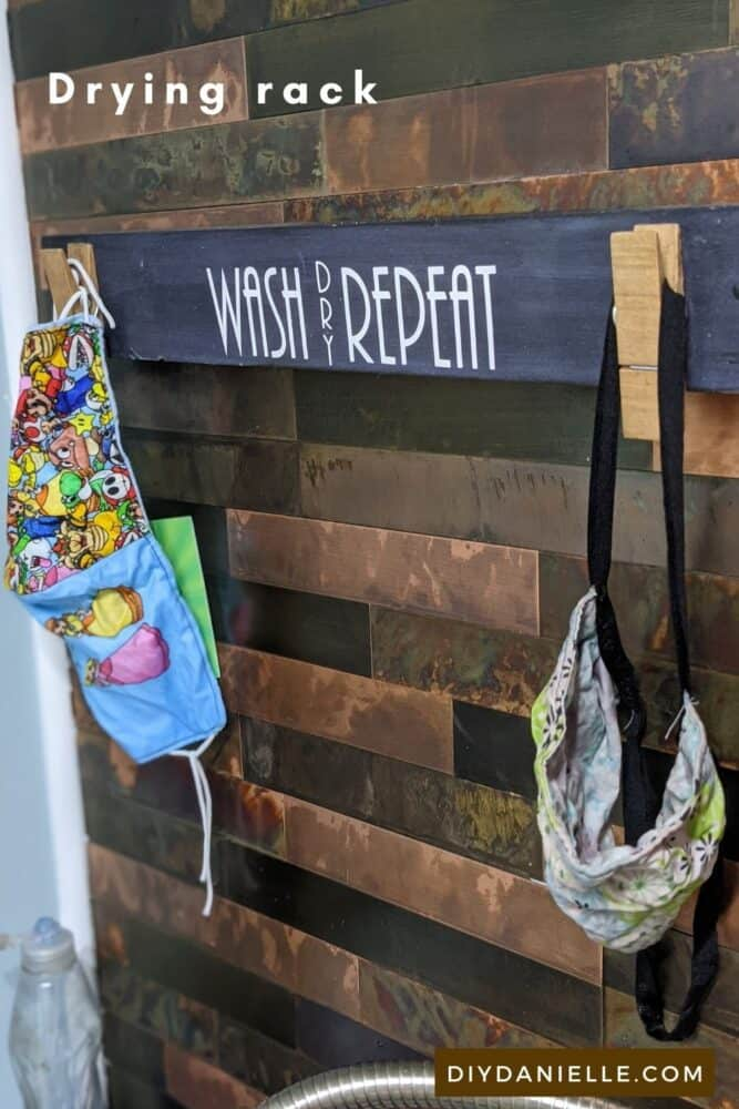 Drying rack for masks. We hand wash in the laundry sink, then hang dry above on this simple DIY rack.