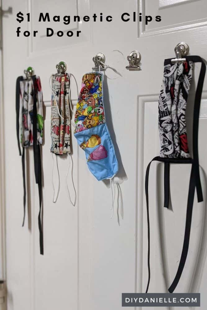 $1 magnetic clips from the Dollar Tree stuck to our exterior door. Hard to miss them when we're leaving the house.