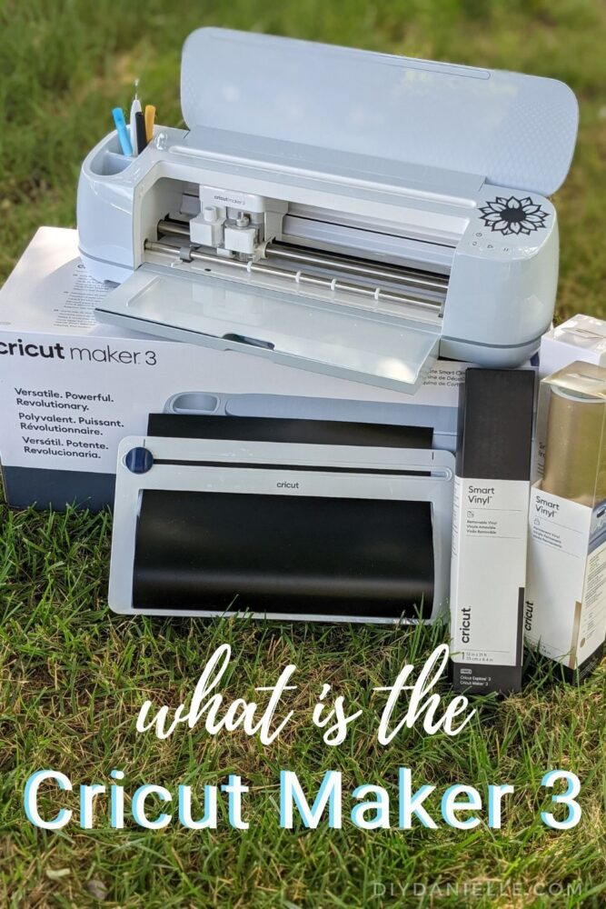 """Photo of the Cricut Maker 3, the roll holder with black permanent vinyl in it, and a few boxes of SmartVinyl. Text says: """"What is the Cricut Maker 3"""""""