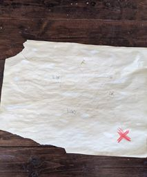 tea stained paper with kids drawing