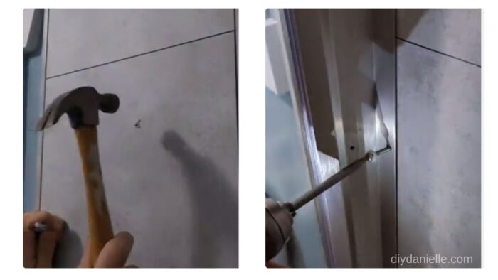 Screwing the frame into the wall.