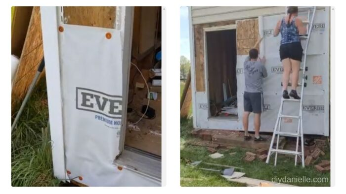 Installing house wrap on our shed.