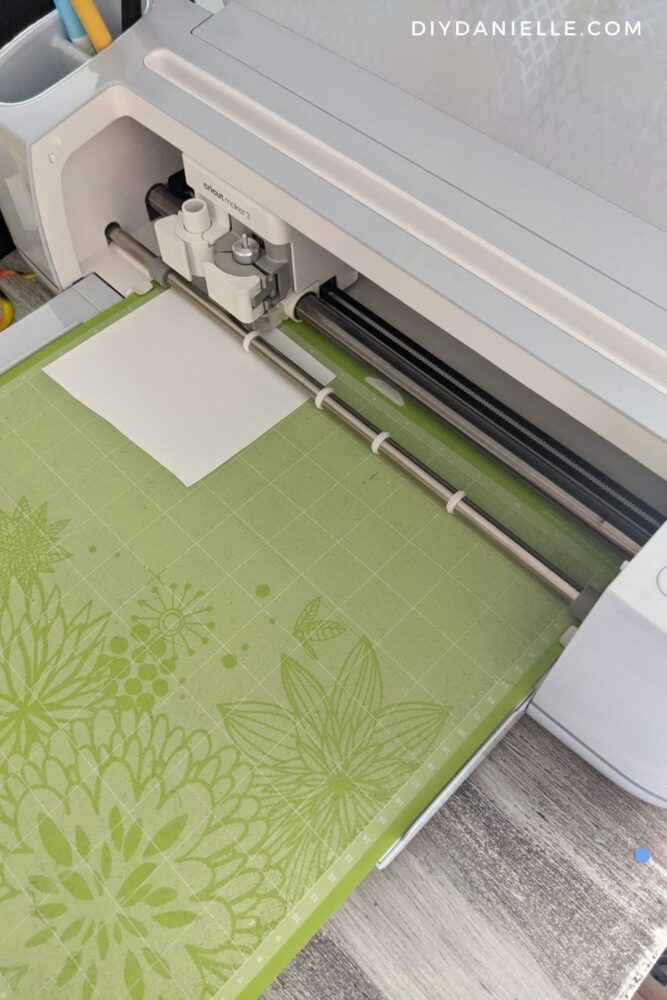 Cutting iron on vinyl with the Cricut Maker 3 on the green mat.