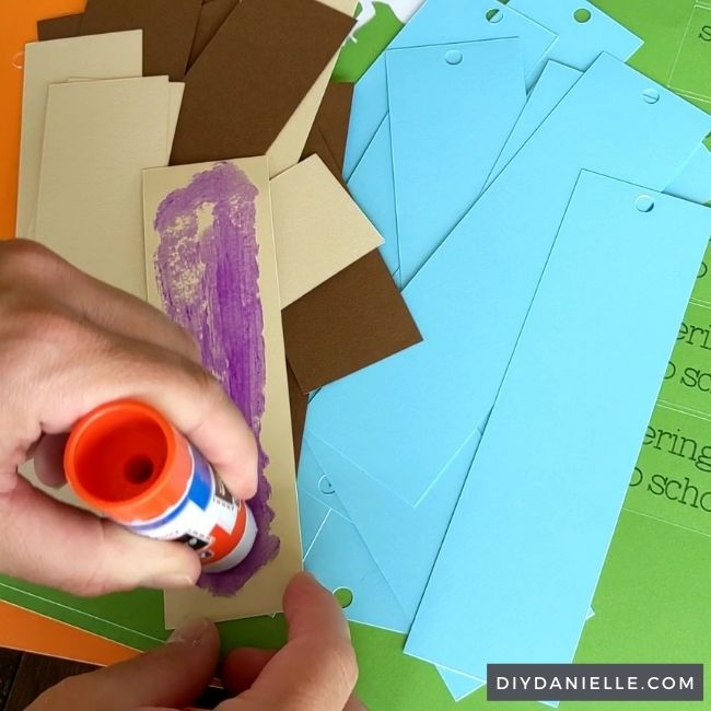 Gluing pieces of cardstock to the bookmark.