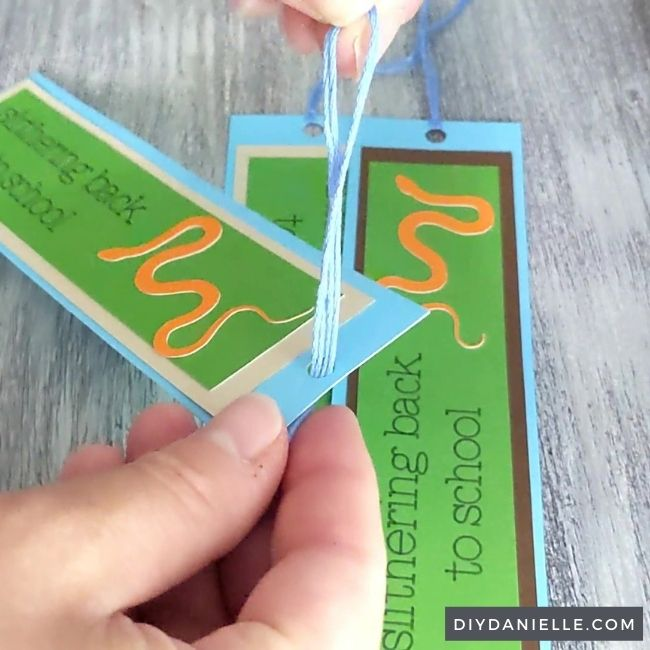 Creating the tassel: step 1  Pulling the loop through the hole at the top of the bookmark.